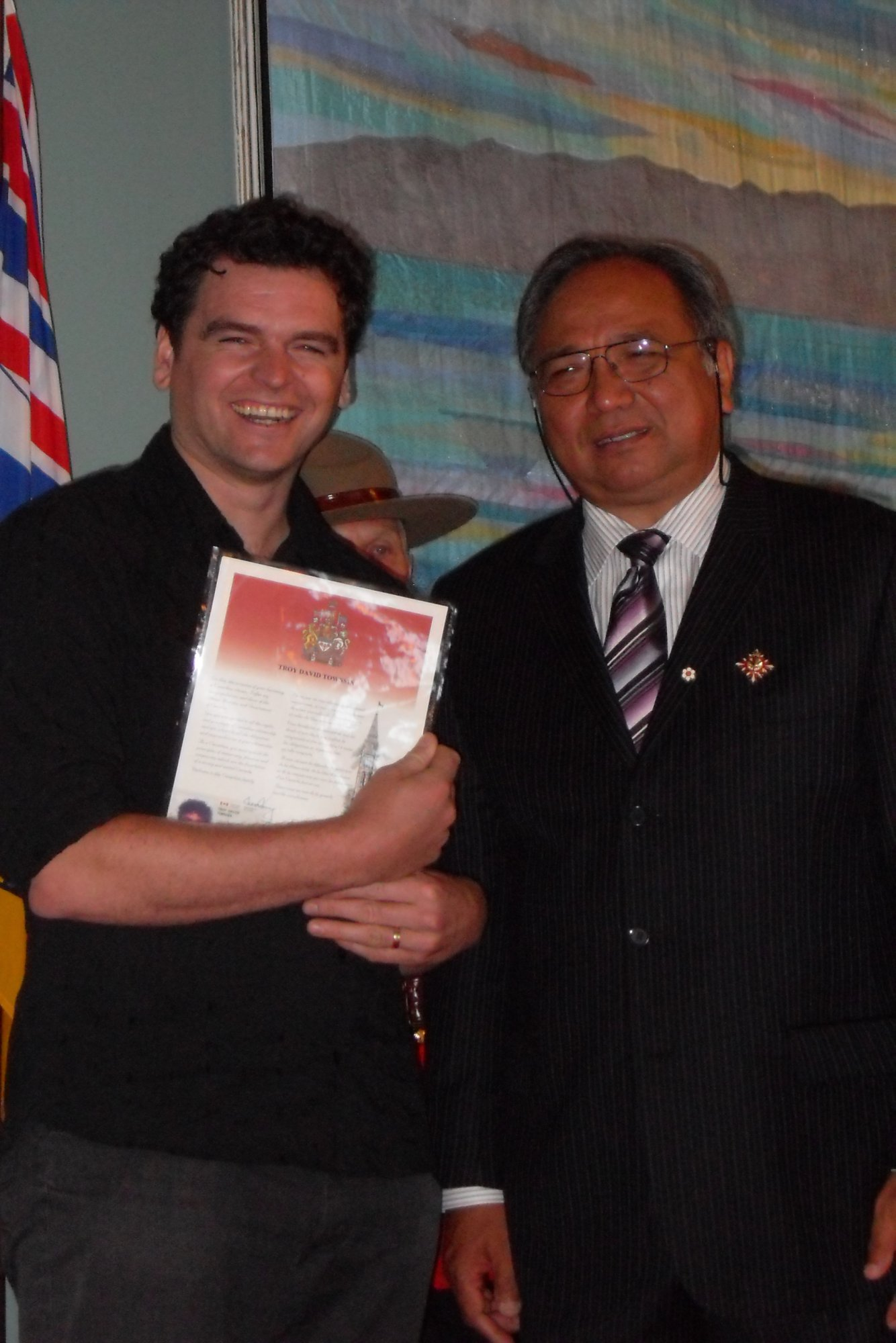Troy with the Honourable Steven L. Point at his citizenship ceremony